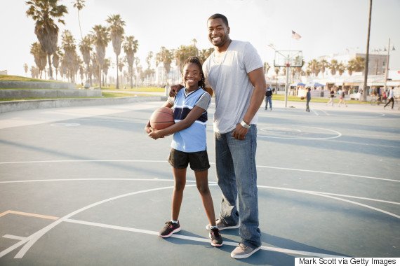 black father and daughter basketball