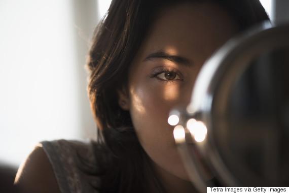 woman looking mirror dark