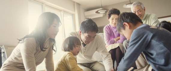 ASIAN FAMILY PLAYING TOGETHER AT HOME