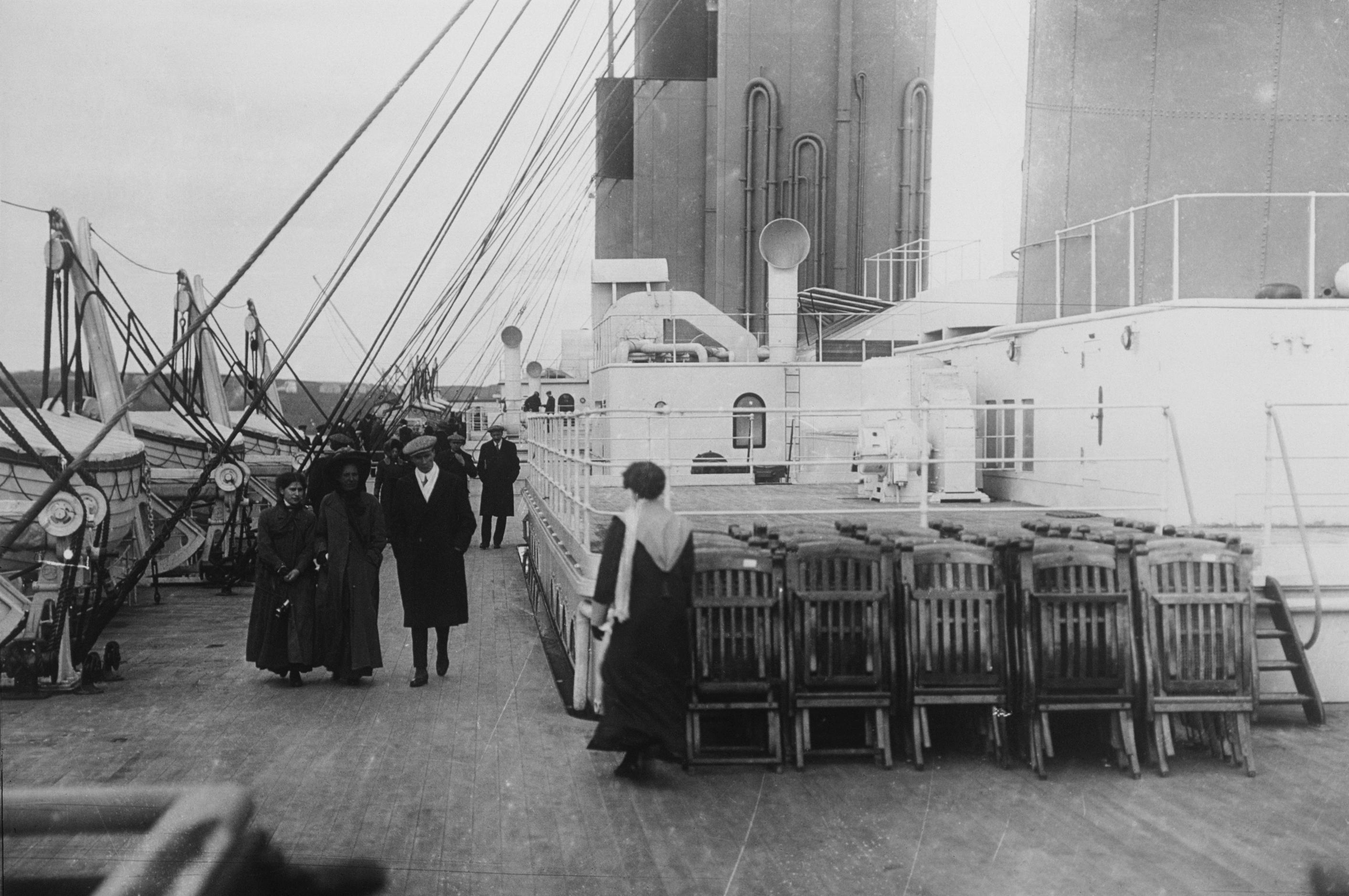 titanic passengers stroll past neatly arranged dec