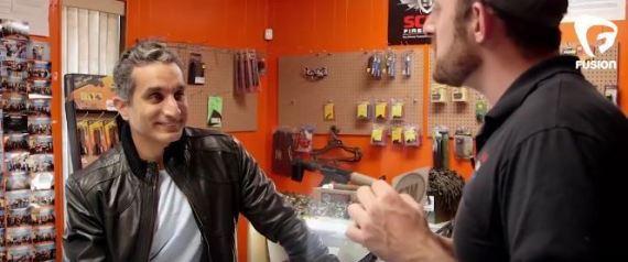 باسم يوسف يزور متجراً للسلاح n-S-large570.jpg