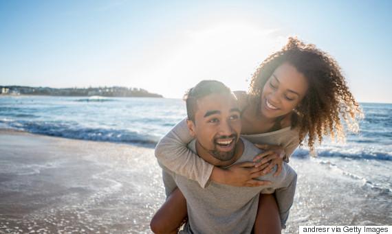 intimate black couple beach