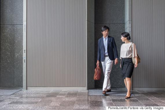 japanese man woman coworkers walk