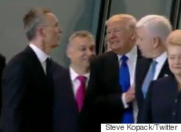 Trump Shoves Grown Man To Stand In Front Of Group Of Adults