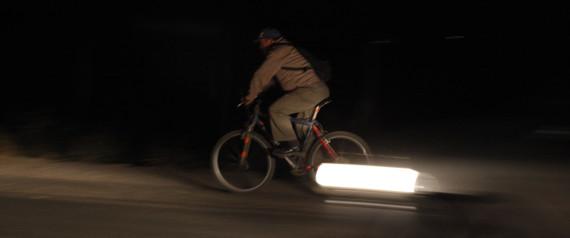 MAN RIDING A BIKE AT NIGHT