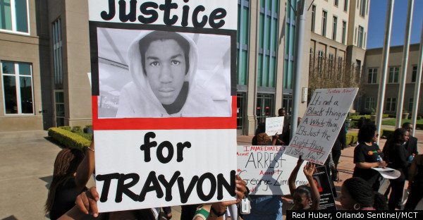 A local demonstration featuring black activists holding up a sign that read Justice For Trayvon