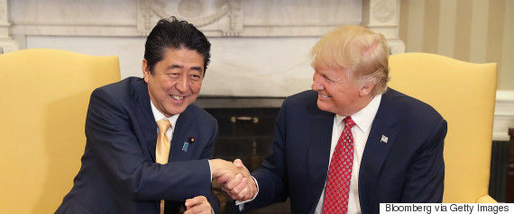trump abe shake hands feb
