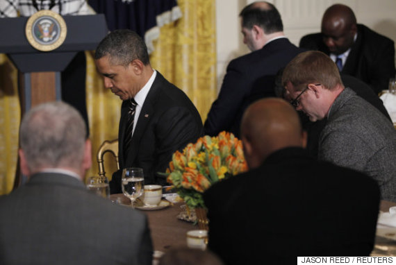 barak obama praying