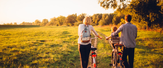 PARENTS CYCLING WITH BABY