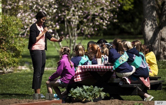 Michelle Obama Plants At Kitchen Garden Event In Blue Sneakers Photos Huffpost