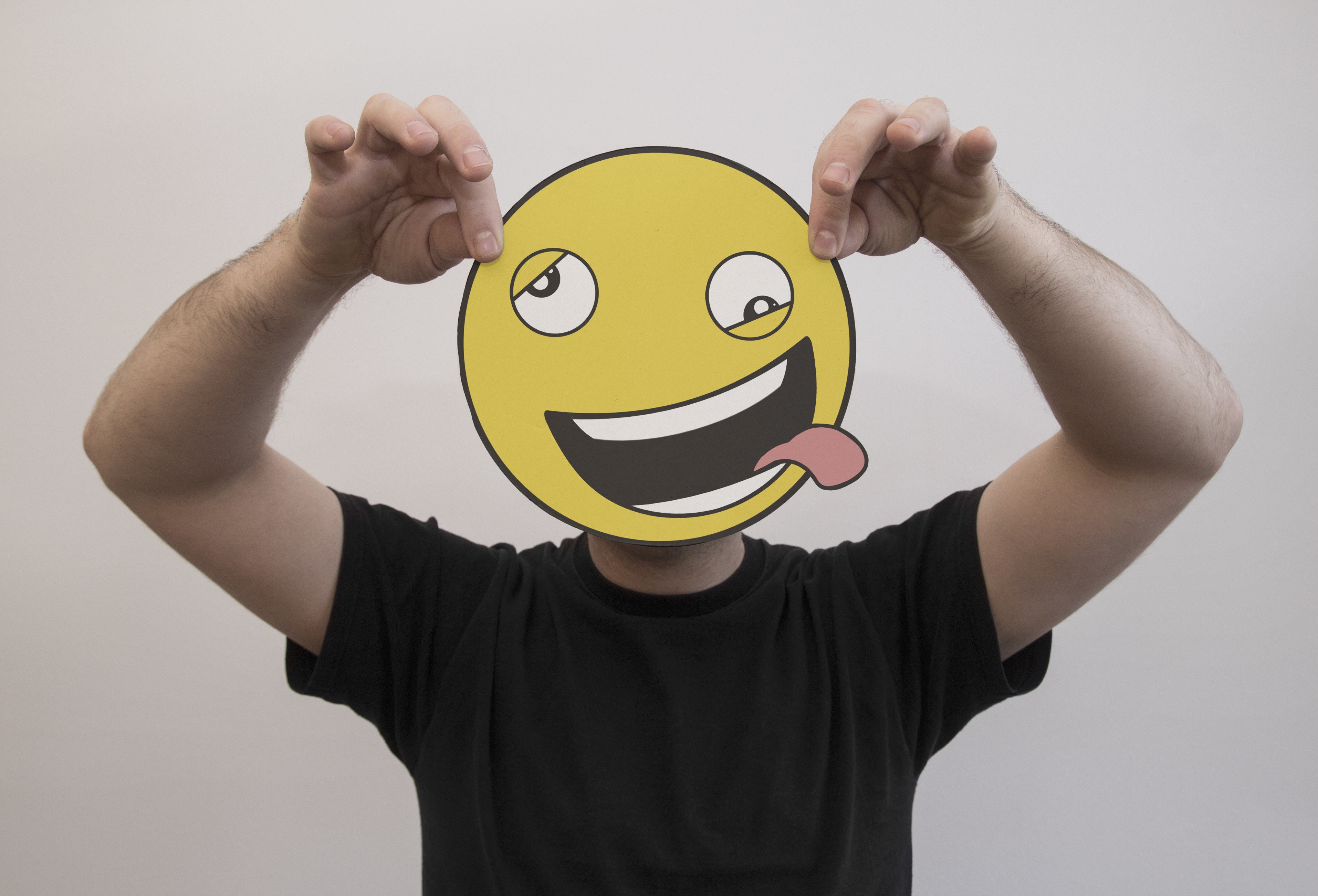 man holding smiley emoji