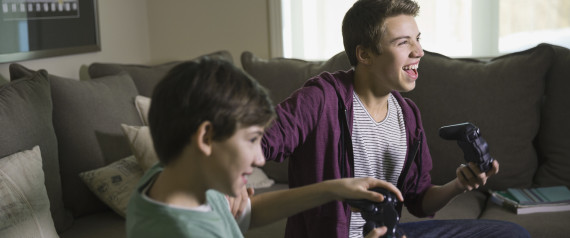 BOYS PLAYING VIDEOGAMES