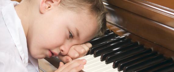 SAD KID PLAYING THE PIANO