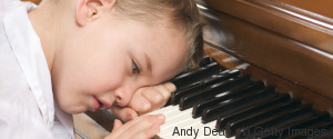 SAD KID PLAYING THE PIANO