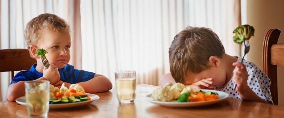 CHILD SAD EATING