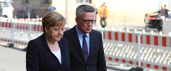THOMAS DE MAIZIERE AND MERKEL