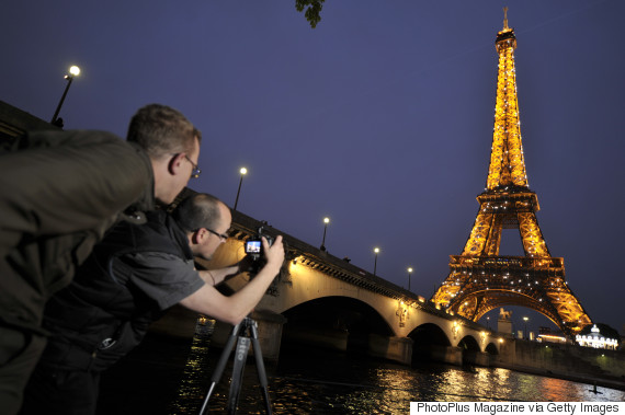 taking photos eiffel tower night