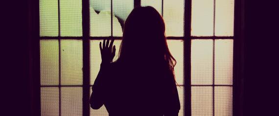 WOMAN BACK WINDOW