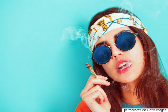 woman smoking sunglasses