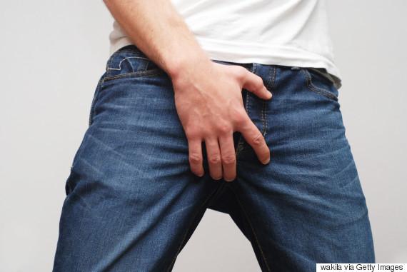 man grabbing crotch