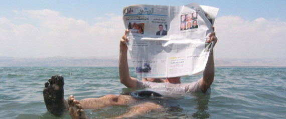READING THE PAPER AT THE DEAD SEA