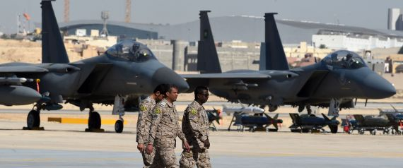 SAUDI ARMY OFFICERS WALK PAST F15 FIGHTER