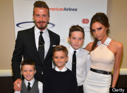 The Beckhams Pose For Family Portrait At Sports Benefit