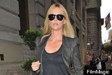 Charlize Theron Misses Snow White LA Premiere, Shows Off Her Bra In New York Instead