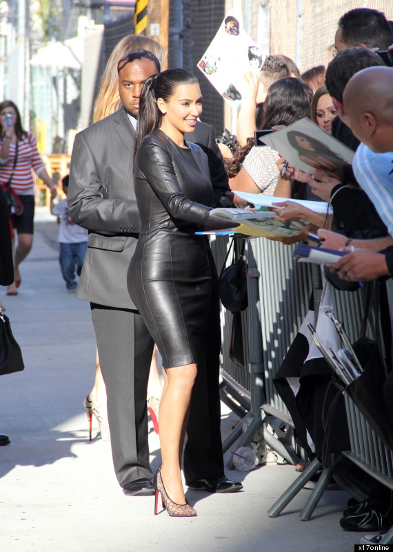 Kim Kardashian Leather Dress Stars Dress Splits Open Photo
