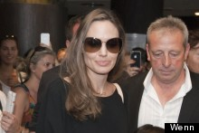 Angelina Jolie Keeps Her Cool In Supersized Shades And Black Trouser Suit