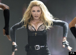 Madonna Defies London Weather For Striptease