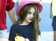 Suri Cruise's Lipstick, Designer Fashions Could Be Getting The Boot (POLL)