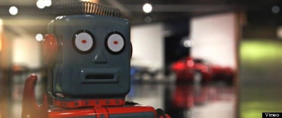 A TOY ROBOT VISITS THE PETERSEN AUTO MUSEUM