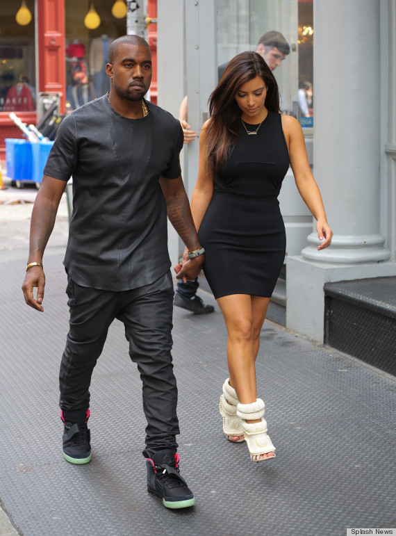Kim kardashian wears kanye west s shoes again photos