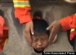 Chinese Kid Stuck In Guardrail