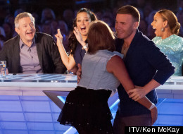 PHOTOS: Gary Barlow Fends Off 'X Factor' Contestant
