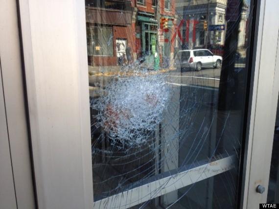 bank robber stuck glass