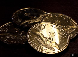 Le dollar canadien clôture sous les 70 cents US