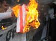 US Embassy Protests: Flag Burned During Demonstration Outside London Consulate (PICTURES)