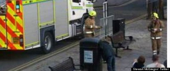 man trapped in bin