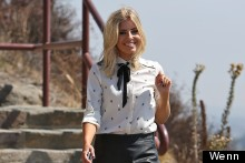 Mollie King Wears Lederhosen And Heels For Photo Shoot