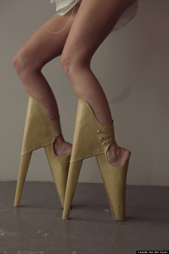 Scary Beautiful: Model Walks At 90 Degree Angle In Backward High Heels