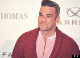 Robbie Williams Gets a Much Needed Hair Transplant