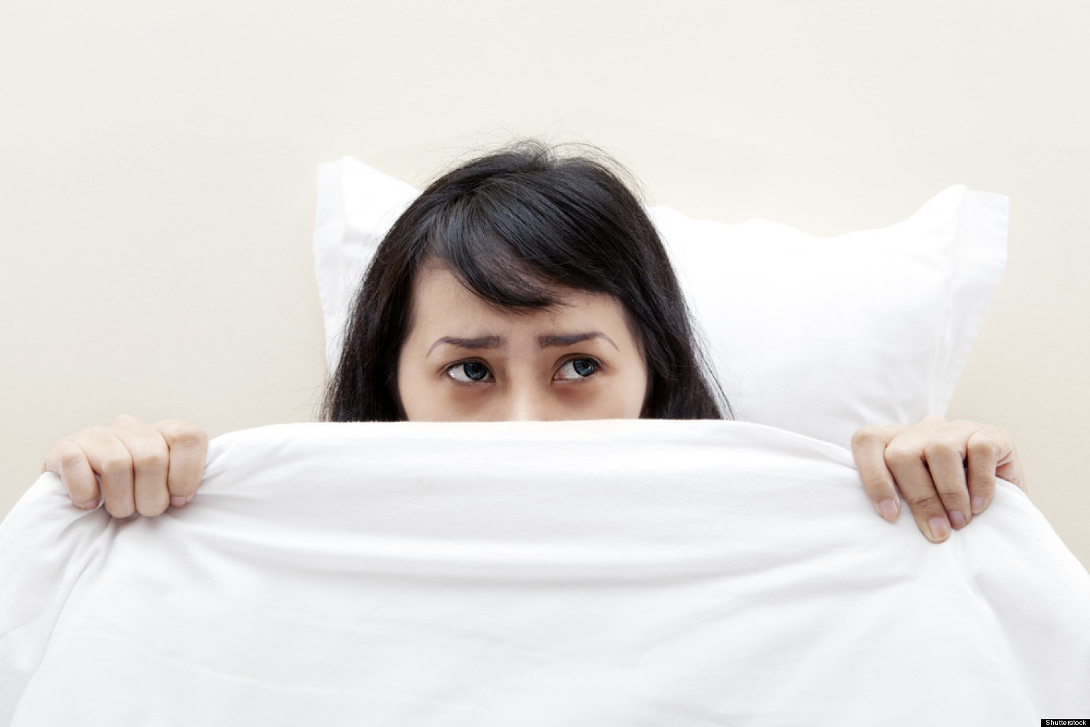 Scared person in bed
