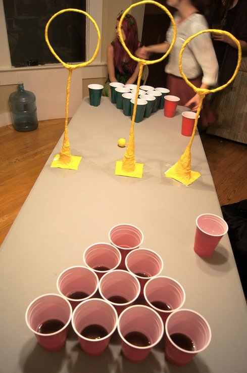 """how to prepare and play the popular drinking game beer pong Beer pong is a popular drinking game, a competitive """"team sport,"""" and for weekend warriors, it's a way of life simple to play, easy to learn, and entertaining for players and spectators alike, beer pong is a backyard barbecue, bar league, basement, and tailgating favorite."""