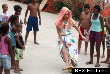 Ball Skills: Lady Gaga Dons A Dress And Pink Wig To Play Footie With Rio Locals