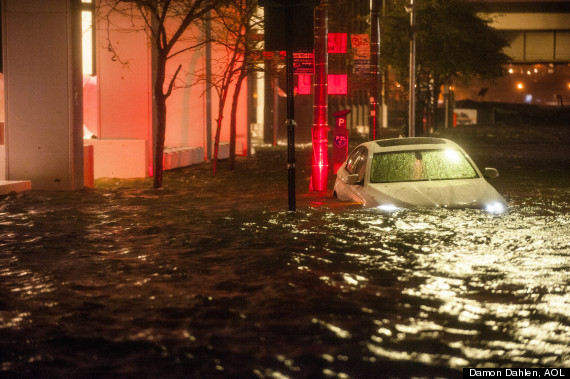 hurricane sandy night car floating
