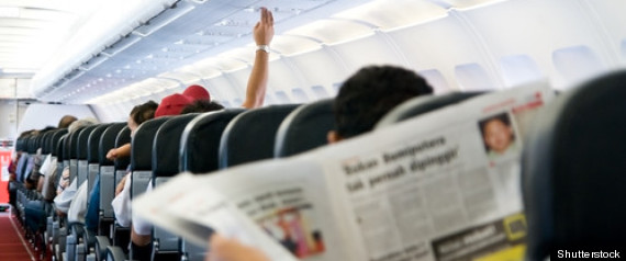 PLANE SEAT NEWSPAPER