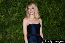 All That Glitters: Emma Stone Wows In Marine Peplum And Sparkly Skirt At Vogue Awards