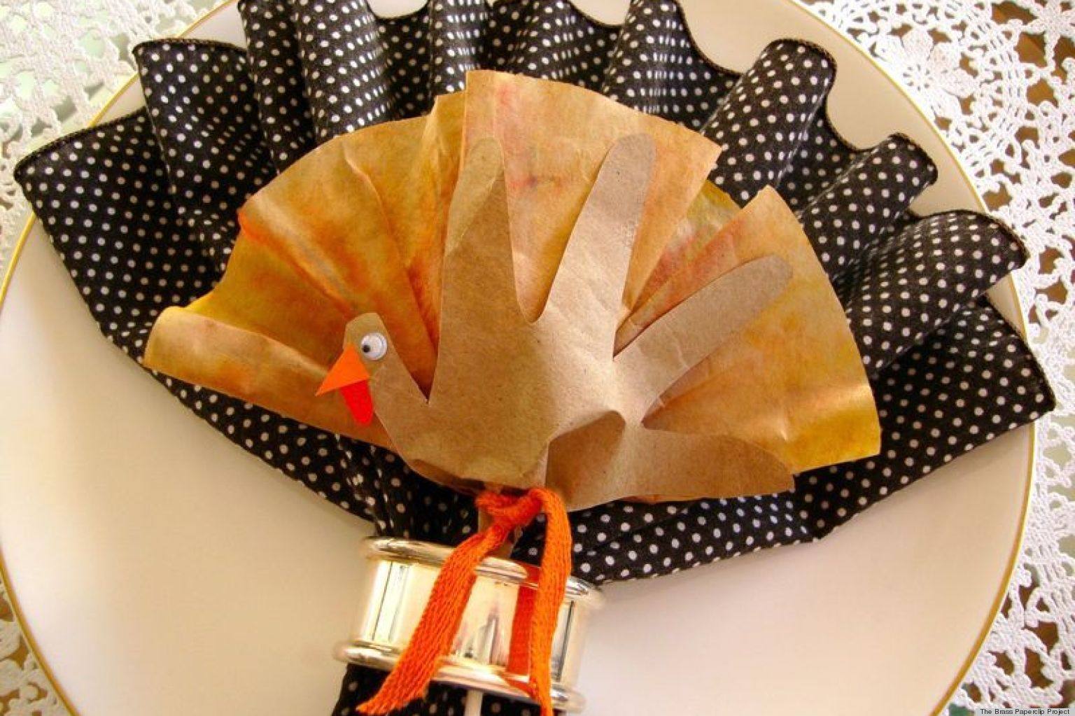 Napkin folding ideas a cute turkey inspired craft for for How to fold napkins into turkeys